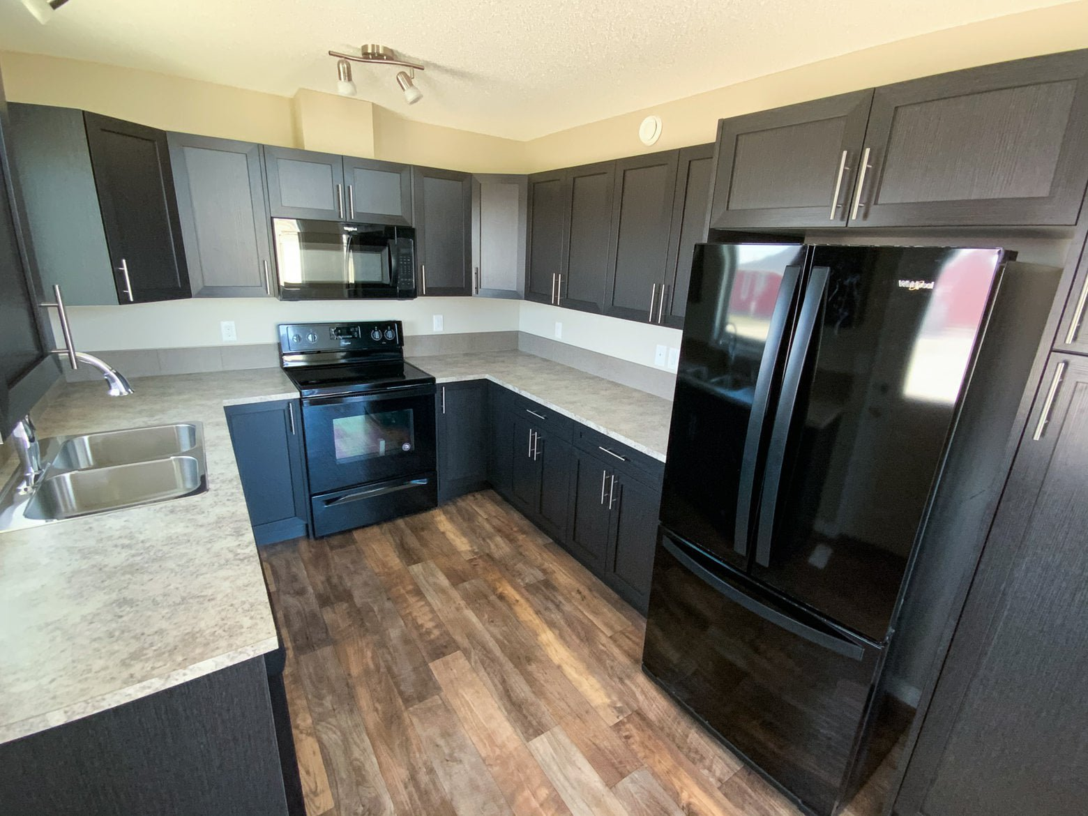 modular dark kitchen in a pre built ready to move home.jpg